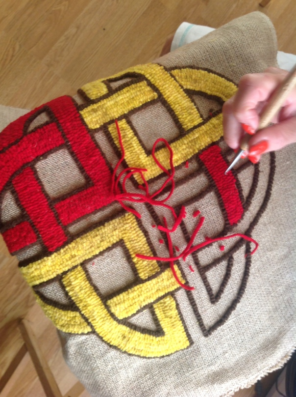 celtic hooked rug in progress